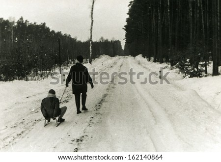 Vintage photo of mother and daughter enjoying winter, fifties - stock photo