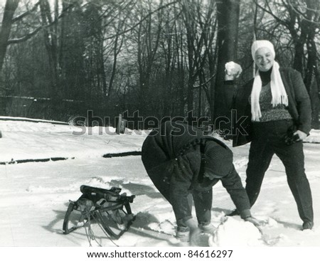 Vintage photo of mother and daughter enjoying winter (fifties) - stock photo