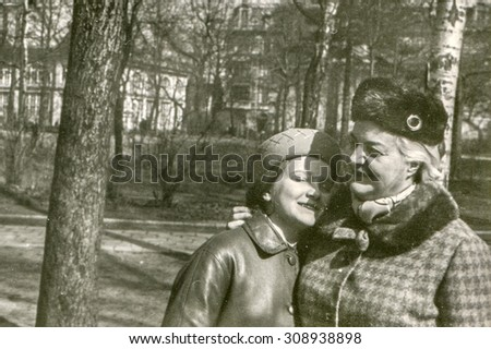 Vintage photo of mother and daughter in park, 1950's - stock photo
