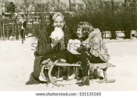 Vintage photo of mother and daughter in winter (fifties) - stock photo