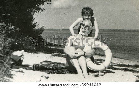 Vintage photo of mother and daughter (late fifties) - stock photo