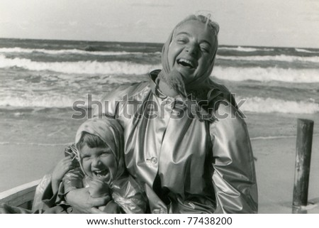 Vintage photo of mother and daughter laughing (fifties) - stock photo