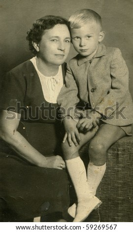 Vintage photo of mother and son - stock photo