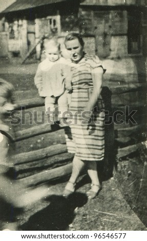 Vintage photo of mother with baby girl (fifties)