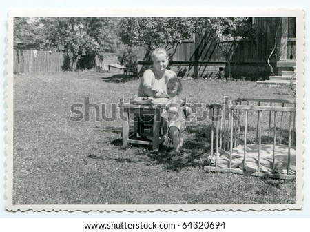 Vintage photo of mother with daughter (fifties) - stock photo