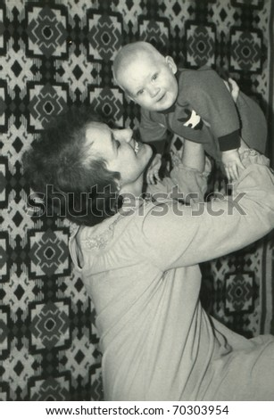 Vintage photo of mother with her baby son - stock photo