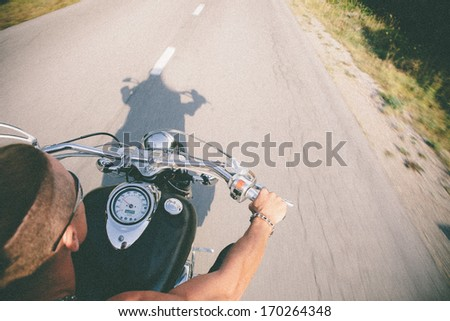 Vintage Photo Of Motorbike Rider Having Fun On Countryside.Vintage effect and grain applied. - stock photo