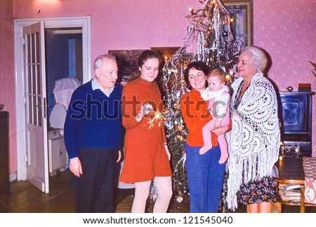 Vintage photo of multigenerational family near Christmas tree (early seventies) - stock photo
