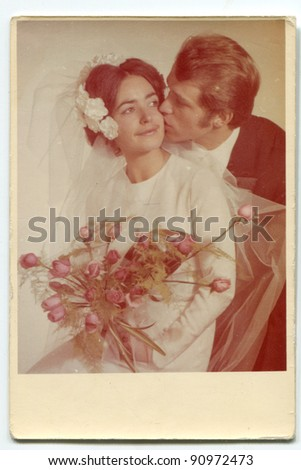 Vintage photo of newlyweds (early seventies) - stock photo