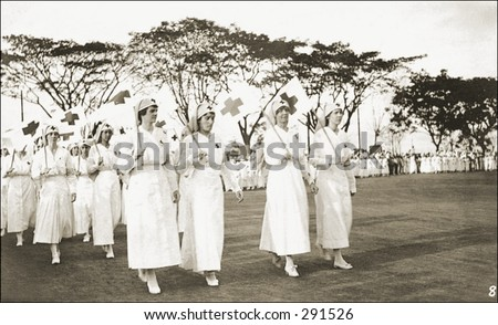 Vintage photo of Nurses In Uniform Marching For A Cause - stock photo