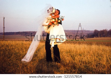 Vintage photo of of newlyweds outdoor (seventies) - stock photo