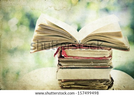 Vintage photo of old books on colorful bokeh background - stock photo