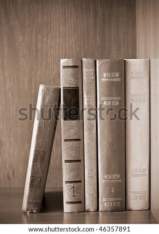 vintage photo of old books on the shelf - stock photo