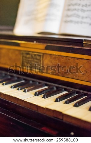 Vintage photo of old piano with notes. - stock photo