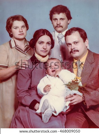 Vintage photo of parents, God parents and a baby boy (Christening), early 1980's