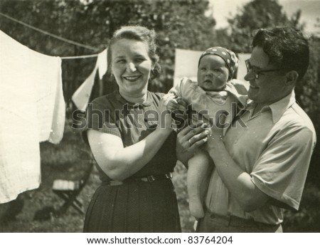 Vintage photo of parents with daughter (fifties)