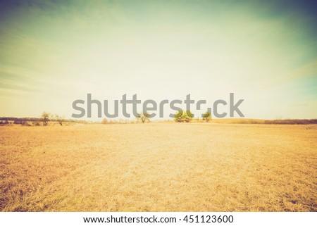 Vintage photo of plowed field landscape at springtime. Natural background - stock photo