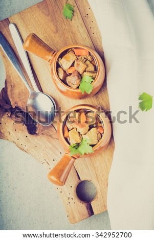 Vintage photo of portion of traditional beef stew with carrots - stock photo