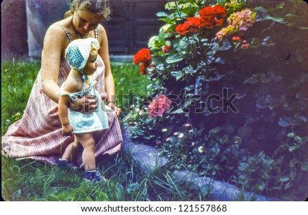 Vintage photo of pregnant mother and daughter (1981) - stock photo