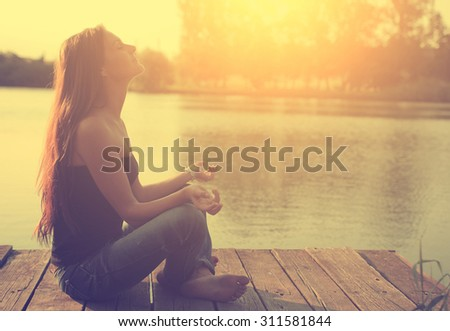 Vintage photo of relaxing young woman in nature - stock photo