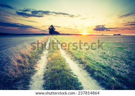 vintage photo of rural landscape at sunset - stock photo