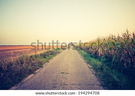 vintage photo of rural road - stock photo