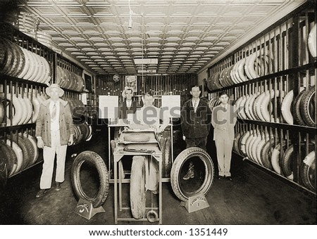 Vintage photo of Salesmen In Tire Store Showroom - stock photo