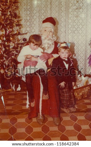Vintage photo of Santa Claus with little children (early eighties)