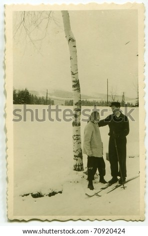Vintage photo of skier and his wife (fifties) - stock photo