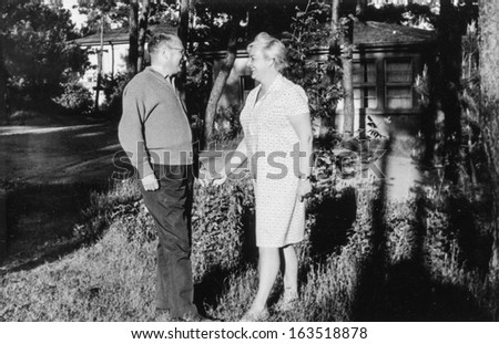 Vintage photo of smiling mature couple (fifties) - stock photo