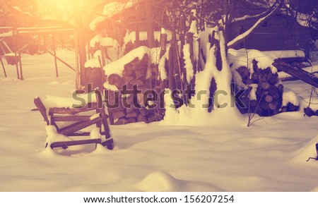 Vintage photo of snow covered wood stack - stock photo