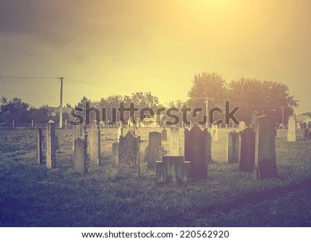 Vintage photo of spooky cemetery - stock photo