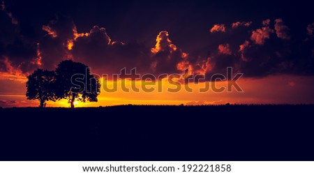 vintage photo of sunset on field. rural landscape