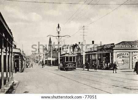 Vintage photo of the main street of a town, circa 1900 - stock photo