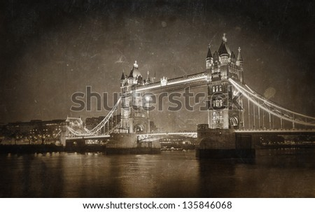 Vintage photo of Tower bridge at night, London