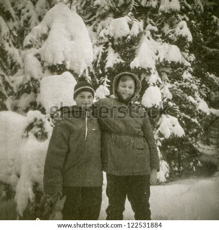 Vintage photo of two boys in winter (fifties) - stock photo