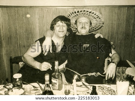 Vintage photo of two brothers in costumes during a fancy dress party, early eighties