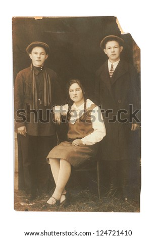 Vintage photo of two men and woman (Russia, beginning of the 20th century) - stock photo