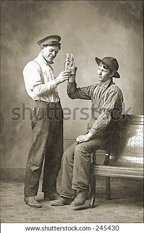 Vintage Photo of Two Men Toasting With Beer - stock photo