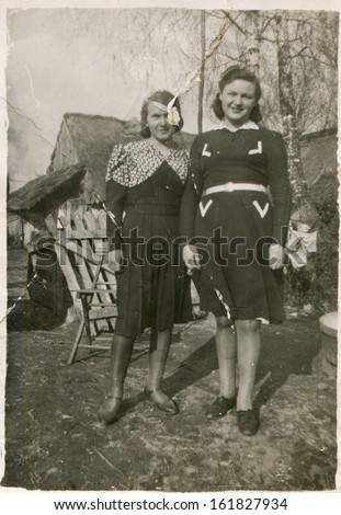 Vintage photo of two sisters (forties) - stock photo