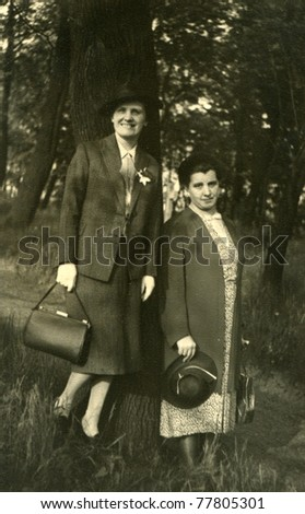 Vintage photo of two woman outdoor (thirties or forties) - stock photo