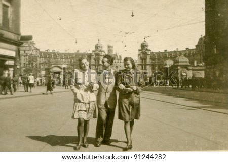 Vintage photo of two women and a man (forties) - stock photo