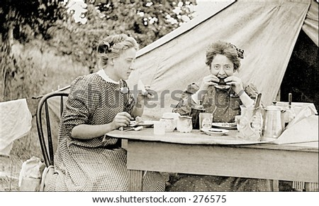 Vintage Photo of Two Women Eating Outdoors - stock photo
