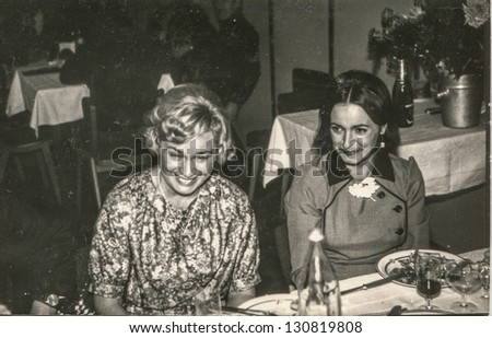 Vintage photo of two women having fun at a party (seventies) - stock photo