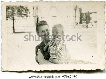 Vintage photo of woman with baby (forties) - stock photo
