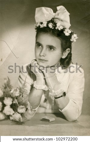 Vintage photo of young girl - First communion (sixties) - stock photo