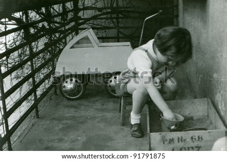 Vintage photo of young girl playing outdoor (fifties) - stock photo