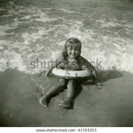 Vintage photo of young girl with life buoy (fifties) - stock photo