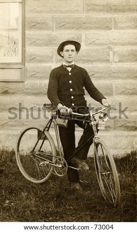 Vintage photo of young man with bicycle, circa 1900