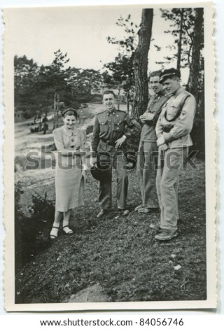 Vintage photo of young people outdoor (thirties)